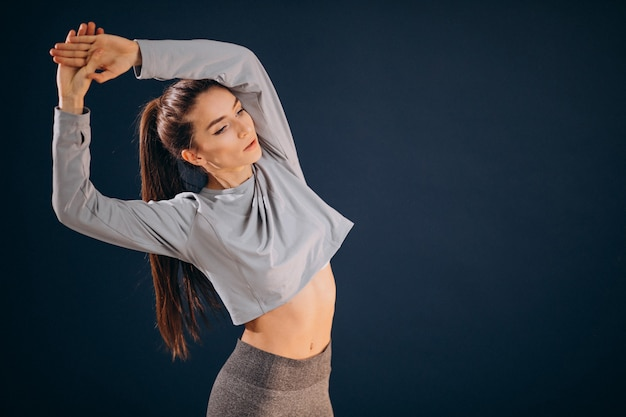 Young sporty woman soing stretches