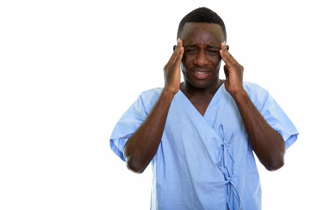 Young stressed black african man patient having headache