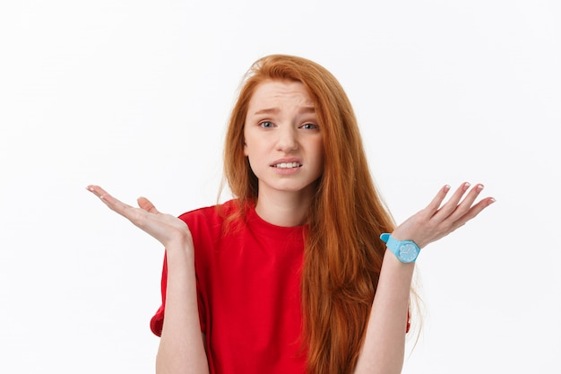 Young stressed european blonde woman looking at camera isolated on white