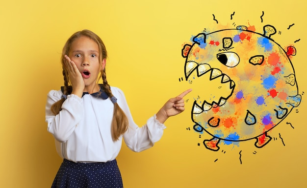 Young student is with shocked expression and indicates covid-19 virus