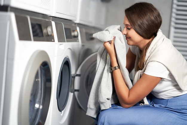 Young student in laundry room