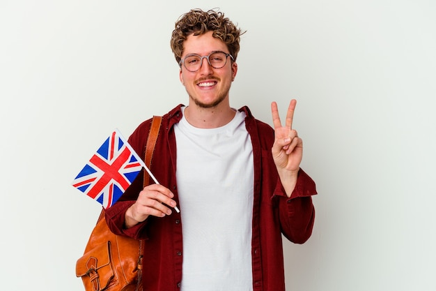 Young student man learning english isolated on white background showing number two with fingers.