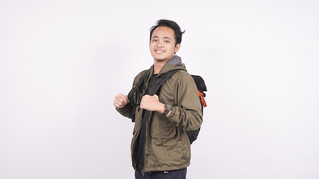 Young student man wearing a bag, isolated on white backgroud