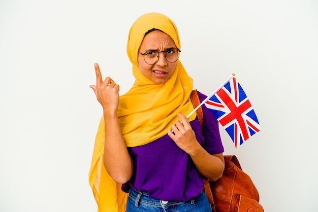 Young student muslim woman isolated on white wall showing a disappointment gesture with forefinger.
