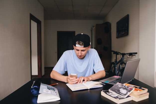 A young student uses a telephone while studying. teaching at home.