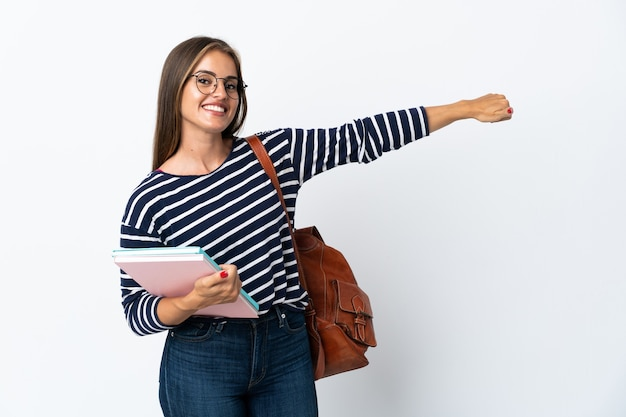 Young student woman isolated giving a thumbs up gesture