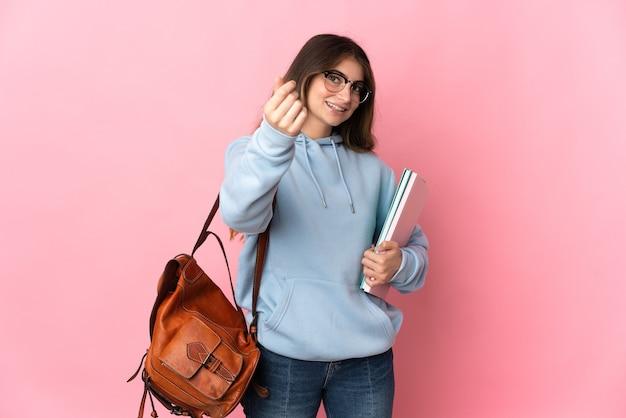 Молодая студентка женщина изолирована делая денежный жест