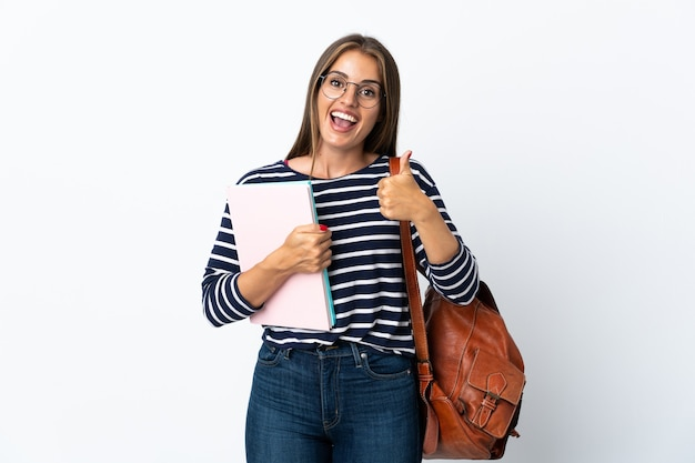 Young student woman isolated showing ok sign and thumb up gesture