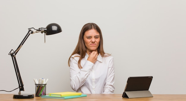 Young student woman working on her desk coughing, sick due a virus or infection