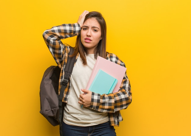 Young student woman worried and overwhelmed