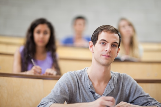 Young students listening during a lecture