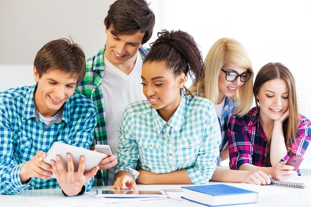 Young students studying on library background