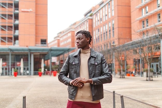Young stylish afro-american guy in the streets of lyon in france