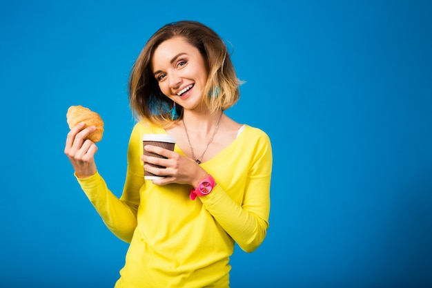 Young stylish attractive woman in yellow blouse on blue