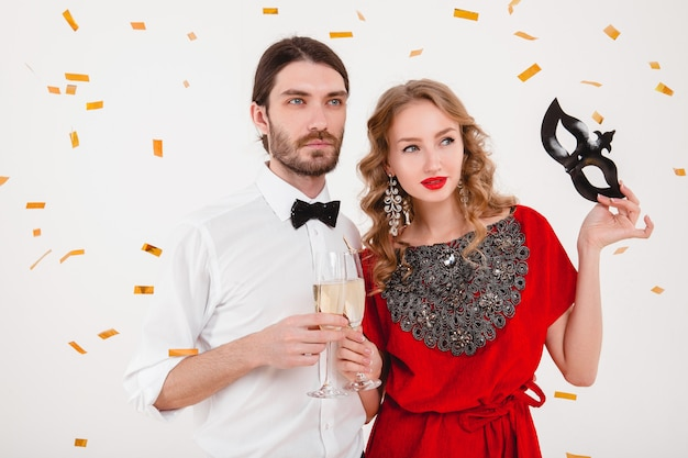 Young stylish couple in love celebrating new year and drinking champagne