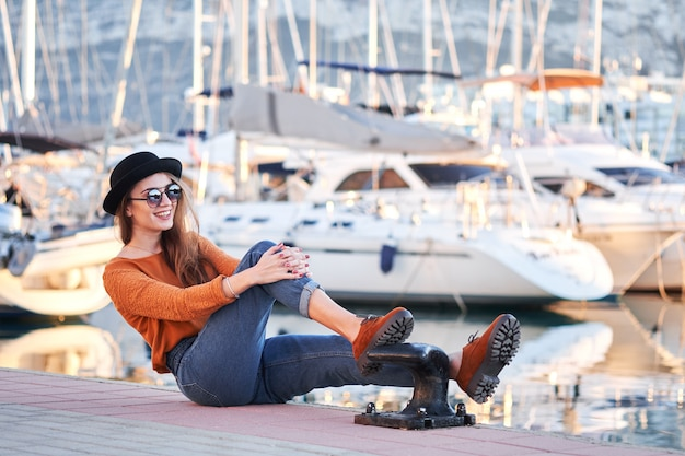 Young stylish girl in a sea port