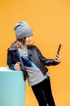Young stylish girl taking selfie