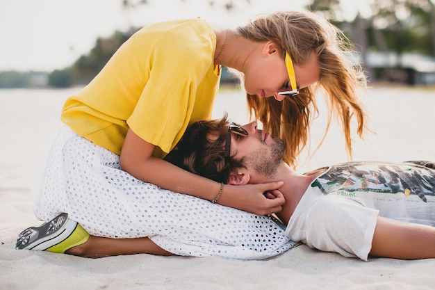 Young stylish hipster couple in love on tropical beach during vacation