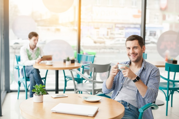 Young stylish man in cafe