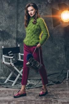 Young stylish sexy woman on cinema backstage