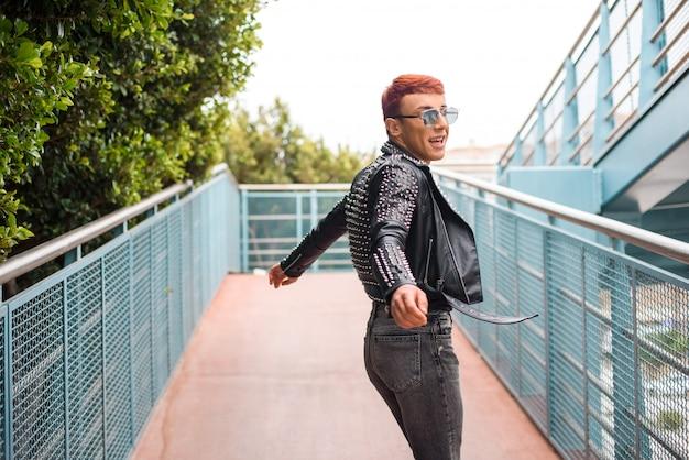 Young stylish wearing man turning around on a bridge