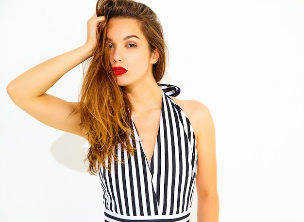 Young stylish woman model in casual summer striped suit with red lips, isolated