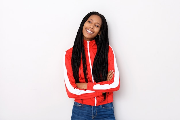 Young stylish woman in red jacket standing with arms crossed on white background