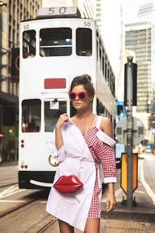 Young stylish woman  walking along the street of hong kong city