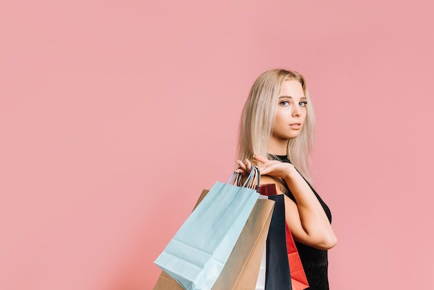 Young stylish woman with bags