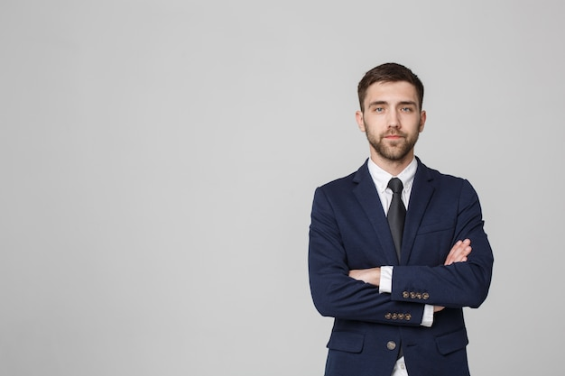 Young successful businessman posing over dark background. isolated white background. copy space.