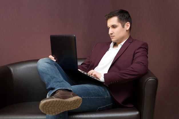 Young successful businessman with a laptop in hand.