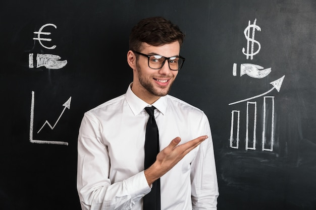 Young successful man in white shirt presenting new financial project