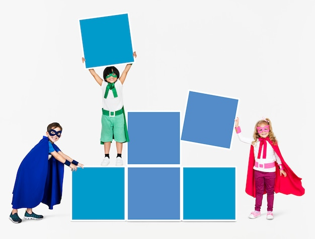 Young superheroes stacking empty boxes