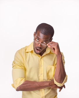 Young surprised black african man, thinking and looking up  on white background