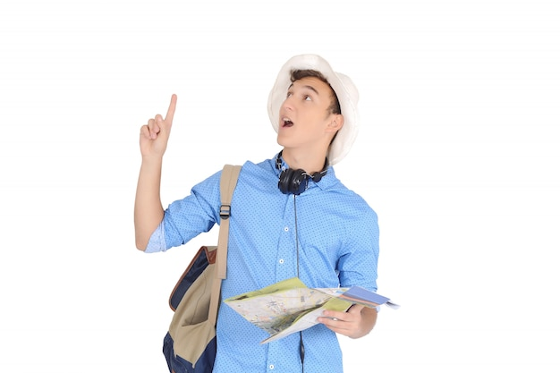 Young surprised tourist pointing his finger up to empty space