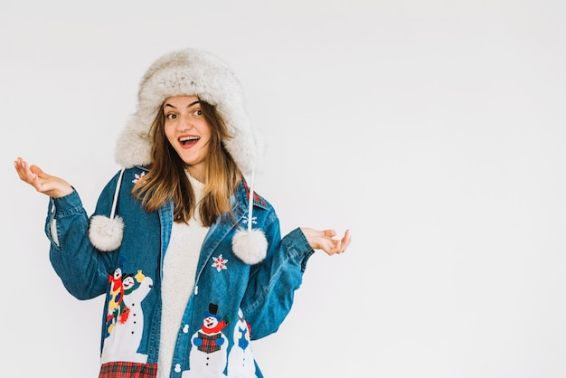 Young surprised woman in fur hat and jean shirt