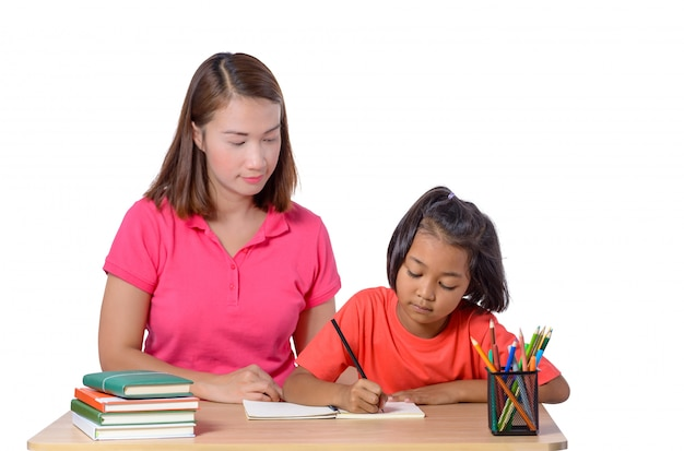 Young teacher helping child with writing lesson isolated on white