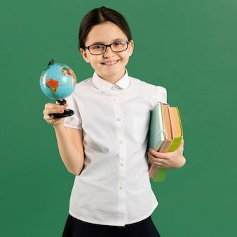 Young teacher holding globe