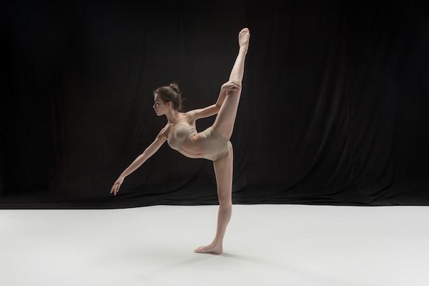 Young teen dancer on white floor