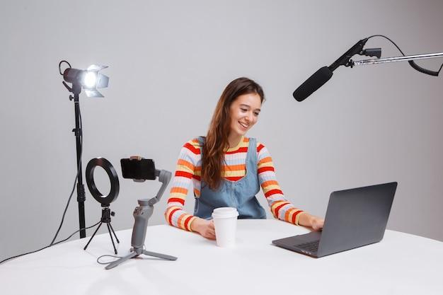 Young teen girl blogger makes a video stream