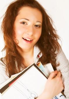 Молодая девушка с книгами
