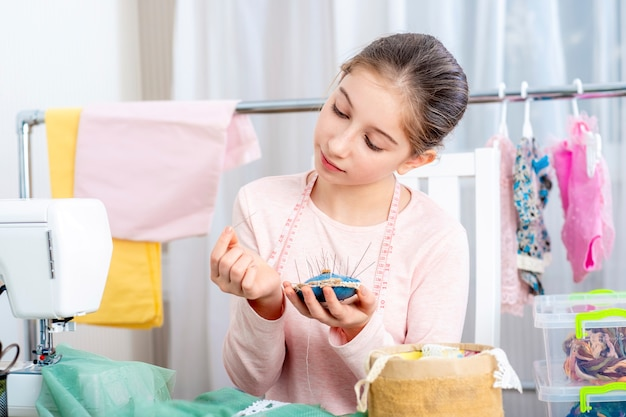 Young teen girl with pincushion