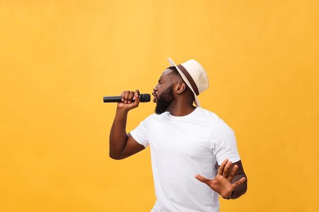 Young teenage black african american boy singer performing