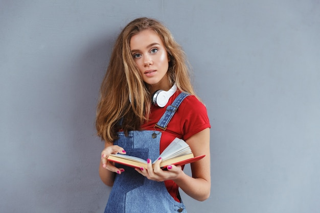 Young teenage girl holding book