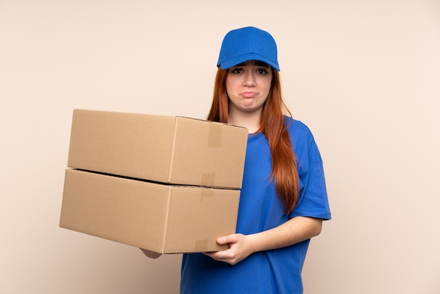 Young teenager delivery woman sad
