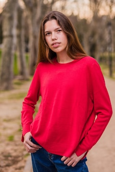 Young teenager girl in a park.  lifestyle  latin female in spain
