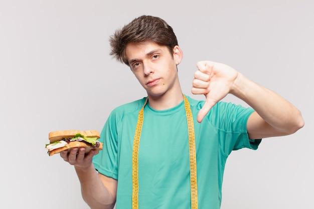 Грустное выражение молодого человека подростка. концепция диеты