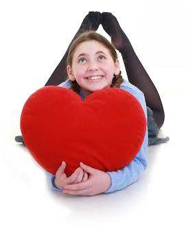 Young teenager with red heart isolated on white background