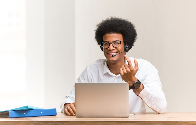 Young telemarketer black man inviting to come