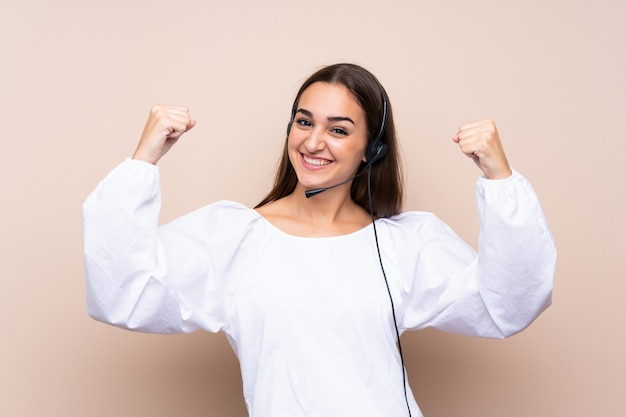 Young telemarketer woman celebrating a victory